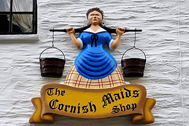 Advertising character above a candy store, Fudgeshop, The Cornish Maids Shop, Polperro, Cornwall, England, United Kingdom, Europe