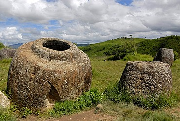 Archeology, ancient large stone jars scattered in the landscape, Plain of Jars, Jar Site 1, Thong Hai Hin, near Phonsavan, province of Xieng Khouang, Laos, Southeast Asia