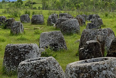 Archeology, large ancient stone jars in the landscape, Plain of Jars, Jar Site 1, Thong Hai Hin, at Phonsavan, Xieng Khouang province, Laos, Southeast Asia