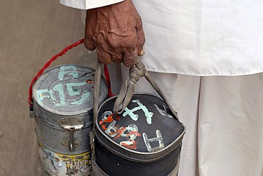 Dabba wallah or food deliverer with Dabbas or food containers marked with characters to allow correct delivery, Mumbai, India, Asia