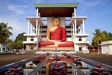 Giant Buddha statue in the Weherahena temple of Matara, Sri Lanka, Asia
