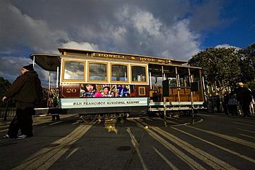 Old cable car of the San Francisco Municipal Railway, Muni, on turntable at final stop, San Francisco, California, USA
