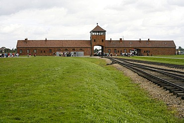 Entrance gate and rail tracks to the concentration camp, Auschwitz-Birkenau, Poland, Europe
