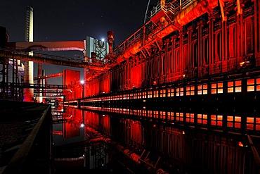 Industrial buildings illuminated at night, Zeche Zollverein Coal Mine, Oberhausen, North Rhine-Westphalia, Germany, Europe