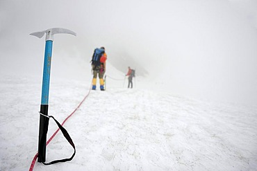 Ice pick with rope team on glacier, Chur, Canton Grisons, Switzerland, Europe