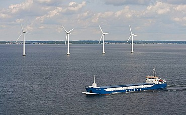 "Cargo ship ""Wilson Astakos"" sailing in front of an offshore wind farm in the oresund outside Copenhagen, Denmark, Europe"