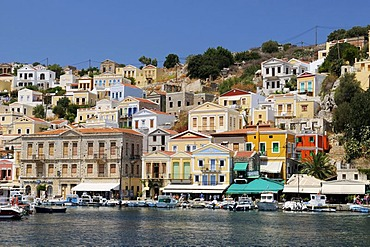 Overlooking the picturesque houses of the small island of Symi near Rhodes, Greece, Europe
