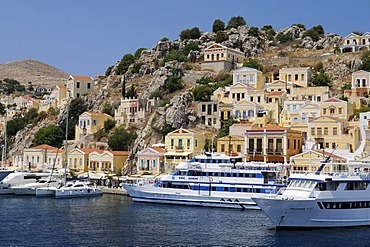 Dock with excursion boats at the center of the island of Symi near Rhodes, Greece, Europe