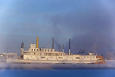 Historic steam ship, stern wheeler, S. S. Klondike, Whitehorse, across the steaming Yukon River, Yukon Territory, Canada