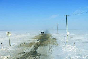 Snow drifts on a northbound road, Saskatchewan, Canada