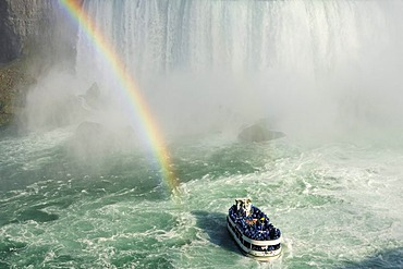 Excursion boat with rainbow directly at the Niagara Falls, Niagara Falls, Ontario, Canada, North America