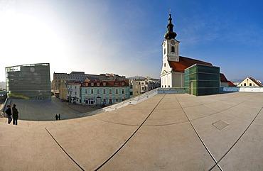 Ars Electronica Center and Uhrfahr parish church in Linz, Upper Austria, Austria, Europe