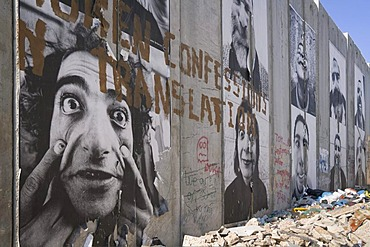 "A group of posters on the controversial ""security fence"", a wall built by the Israelis to separate themselves from the Palestinians, Bethlehem, West Bank, Western Asia"