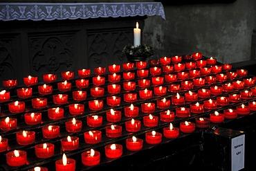 Burning votive candles in a church, St. Martin's Church, Landshut, Lower Bavaria, Bavaria, Germany, Europe