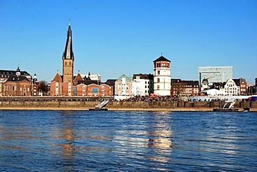 View across the Rhine River to the Basilica of St. Lambertus and Schlossturm tower, headquarters of the Schifffahrtsmuseum or Maritime Museum on the bank of the River Rhine, Burgplatz, old town, Duesseldorf, North Rhine-Westphalia, Germany, Europe