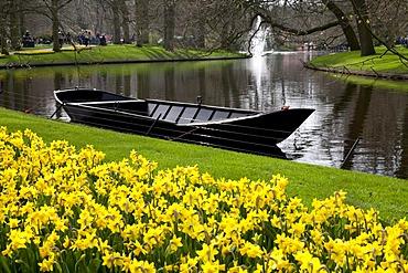 Boat in the Keukenhof flower garden, Lisse, Netherlands, Europe