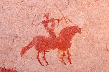 Painted rider on a horse, neolithic rockart of the Acacus Mountains or Tadrart Acacus range, Tassili n'Ajjer National Park, Unesco World Heritage Site, Algeria, Sahara, North Africa