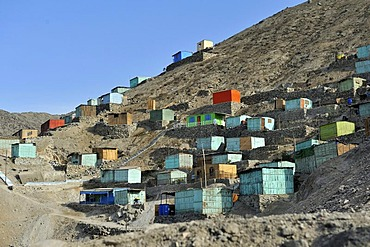 Brightly painted wooden houses built on sandy slopes in the dry desert climate, slums of Amauta, Lima, Peru, South America