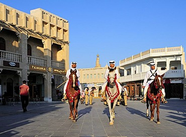 Mounted police in front of the tower of the Islamic Cultural Centre FANAR, Souk Waqif, Doha, Qatar, Middle East