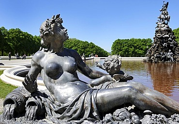 Mythological figure on the edge of the pond of the Fama Fountain, by Rudolf Maison 1884-85, in front of the Schloss Herrenchiemsee Palace, Herrenchiemsee, Bavaria, Germany, Europe