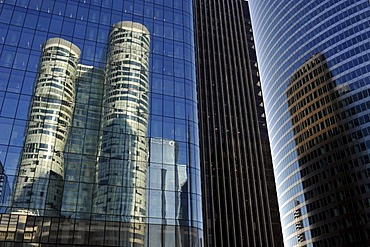 Skyscrapers, Tour Coeur Defense reflected in the glass facade of the Opus 12 building, right Tour EDF tower, La Defense, Paris, France, Europe