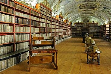 Globes and very old books, library, hall of theology, Strahov Monastery, Prague Castle, Prague, Bohemia, Czech Republic, Europe
