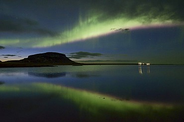 Strong Northern Lights (Aurora borealis) reflected at dusk in the fjord over the Mt. Brimlarhoefi in Grundarfjoerur, SnÊfellsnes, Iceland, Europe