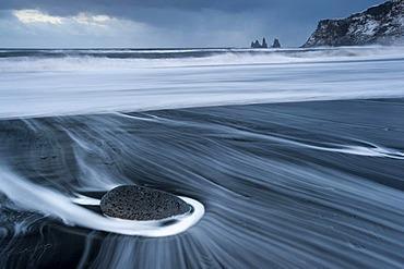 The Reynisdrangar pinnacles on the wintry Reynisfjara beach at Vik I Myrdal, Iceland, Europe
