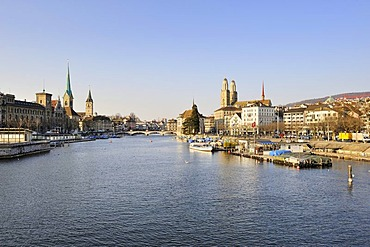 View from the Quai bridge over the River Limmat on the Limmatquai quay and the three city churches, Grossmuenster great minster, St. Peter church and Fraumuenster abbey from the right, Zurich, Canton Zurich, Switzerland, Europe