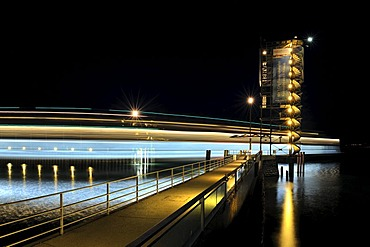Light trace of the moving Euregia ferry and the illuminated Molenturm tower in the ferry port of Friedrichshafen, Bodenseekreis district, Baden-Wuerttemberg, Germany, Europe