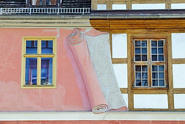 Artistic illustration of a wall being removed to expose a half-timbered facade, Potsdam, Brandenburg, Germany, Europe