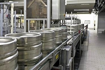 Beer kegs on a conveyor belt, waiting to be filled, Binding brewery, Frankfurt, Hesse, Germany, Europe