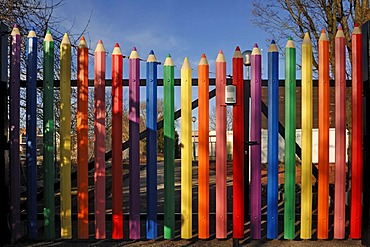 Large coloured pencils forming the gate of the A. Mozart School, Rue de l'Hotel de Ville, Marckolsheim, Alsace, France, Europe