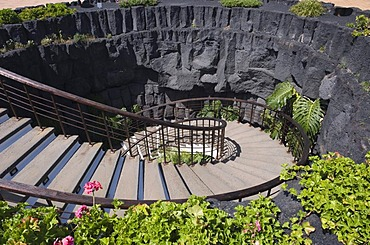 Spiral staircase leading downward into a lava cave, Casa Museo del Campesino farm museum, Mozaga, Lanzarote, Canary Islands, Spain, Europe