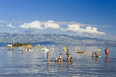Holidaymakers bathing off paradise beach, San Marino, Rab island, Kvarner Gulf, Croatia, Europe