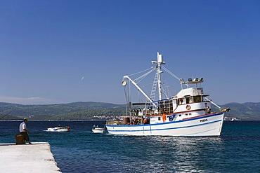 Fishing boat entering the harbour of Orebic, Peljesac Peninsula, Dalmatia, Croatia, Europe