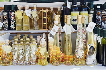 Local specialties and souvenirs on sale at a market stall in the town of Stari Grad, island of Hvar, Dalmatia, Croatia, Europe