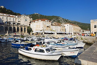 Boats in the harbour, Venetian Loggia, Palace Hotel on St. Stephen's Square, town of Hvar, Hvar Island, Dalmatia, Croatia, Europe