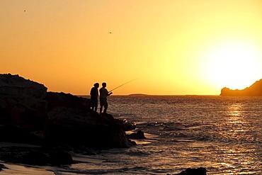 Fisherman enjoying a coastal sunset at Hamelin Bay, Western Australia