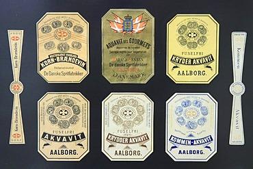 Old Akvavit labels, Aalborg Akvavit spirits factory, Aalborg, North Jutland, Denmark, Europe
