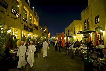 Visitors in the renovated bazaar Souq Waqif, Doha, Qatar, Arabian Peninsula, Middle East