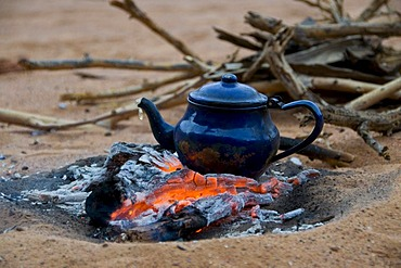 Pot of tea on a camp fire, Tadrat, Algeria, Africa