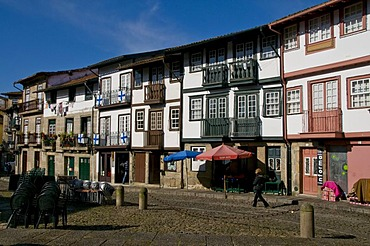 Row of houses with a few small shops, historic district, Guimaraes, Portugal, Europe