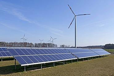 Solar farm and wind turbine near Suedergellersen near Lueneburg, Lower Saxony, Germany, Europe