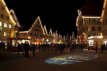 Spotlighted ground, ewa.riss electricity distributor advertising, market square, Biberach an der Riss, Upper Swabia, Baden-Wuerttemberg, Germany, Europe