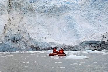 Tourists in a boat off Garibaldi Glacier, Darwin National Park, Tierra del Fuego, Patagonia, Chile, South America
