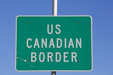 US - Canadian border crossing sign, White Pass, south Klondike Highway, Alaska and British Columbia, B. C., Canada