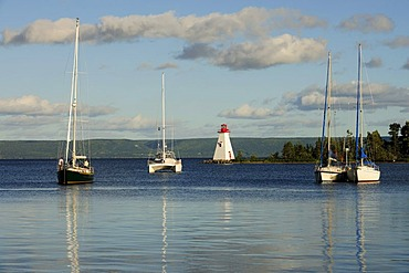 Bras d'Or Lake with lighthouse in the port of Baddeck, Nova Scotia, Canada, North America