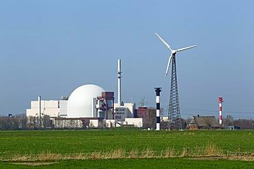 Nuclear power plant Brokdorf and wind turbine, Brokdorf, Wilstermarsch, Kreis Steinburg district, Elbe Marshes, Schleswig-Holstein, Germany, Europe