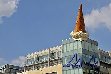 Dropped Cone sculpture, by Claas Oldenburg and Coosje van Bruggen, art on a building, Neumarkt square, Cologne, North Rhine-Westphalia, Germany, Europe